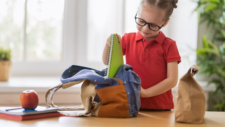a responsible child preparing to school